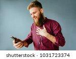 emotional portrait of beard...   Shutterstock . vector #1031723374