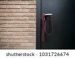 tie on the door handle  | Shutterstock . vector #1031726674