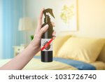 woman holding bottle of anti... | Shutterstock . vector #1031726740
