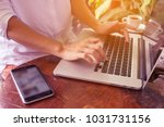 freelance woman's hands on the... | Shutterstock . vector #1031731156