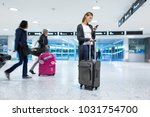 young female passenger at the... | Shutterstock . vector #1031754700