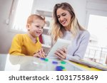 young mother and her son play... | Shutterstock . vector #1031755849