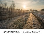 road and roadside with a ditch... | Shutterstock . vector #1031758174
