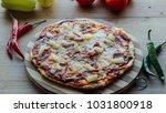 fresh rustic hawaiian pizza on...   Shutterstock . vector #1031800918