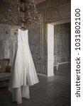 wedding dress hanging   Shutterstock . vector #1031802100
