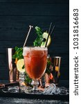 alcoholic cocktail bloody mary. ... | Shutterstock . vector #1031816683