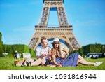 romantic couple having picnic... | Shutterstock . vector #1031816944