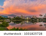 Small photo of storm supercell glows during tropical sunset - near Ala Moana Beach Park in Honolulu Hawaii Oahu