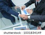 business men making handshake.... | Shutterstock . vector #1031834149