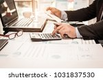 a business man using calculator ... | Shutterstock . vector #1031837530