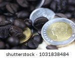 coin thai baht and coffee beans  | Shutterstock . vector #1031838484