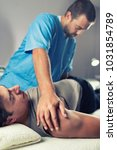physiotherapist doing healing... | Shutterstock . vector #1031854789