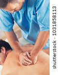 physiotherapist doing healing... | Shutterstock . vector #1031858113