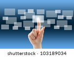 Touch screen interface with hand - stock photo