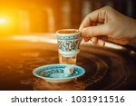 woman hand holding traditional... | Shutterstock . vector #1031911516