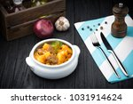 stewed meat with patatoes... | Shutterstock . vector #1031914624