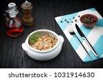 mushrooms in creamy sauce... | Shutterstock . vector #1031914630