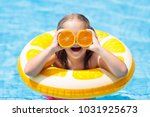 little girl in swimming pool...   Shutterstock . vector #1031925673