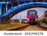 train paring under lit bridge | Shutterstock . vector #1031940178
