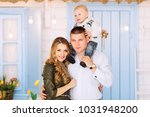 father holding a son on his... | Shutterstock . vector #1031948200