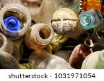 pile of dusty bottles | Shutterstock . vector #1031971054