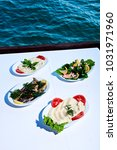 appetizers on table at sea.... | Shutterstock . vector #1031971960