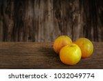 orange fruit on old wooden... | Shutterstock . vector #1032049774