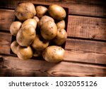Many Russet Potatoes In Crate...