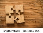 four wooden jigsaw puzzle... | Shutterstock . vector #1032067156