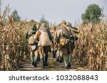 Reenactors Men Dressed As Russian Soviet Red Army Infantry Soldiers Of World War II Marching In Field With Weapon Machine-gun At Historical Reenactment