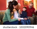 happy smiling grandparents with ... | Shutterstock . vector #1032090946