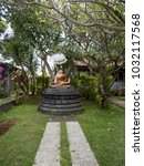Small photo of Statue of the Buddha god in the Buddhist temple Brahma Vihara Arama with statues of the gods on Bali island, Indonesia. Bali Architecture, Ancient design. Travel concept.