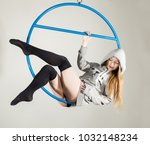 aerial acrobat on a ring. a... | Shutterstock . vector #1032148234