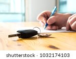 man signing car insurance... | Shutterstock . vector #1032174103