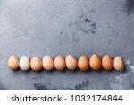 guinea fowl eggs on concrete... | Shutterstock . vector #1032174844