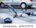 helmet and bike lying on the... | Shutterstock . vector #1032179770