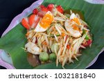thai papaya salad and salted egg | Shutterstock . vector #1032181840