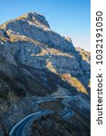 Small photo of Travel exploring concept - curvy road in the high Albanian Alps, Tamara, Albania