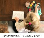 overhead view of child painting | Shutterstock . vector #1032191704