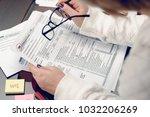 woman fills the tax form ... | Shutterstock . vector #1032206269