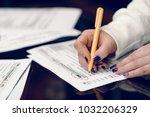 woman fills the tax form ... | Shutterstock . vector #1032206329