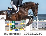 Stock photo horse jumping equestrian events 1032212260