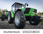 green tractor with big wheels.   Shutterstock . vector #1032218023