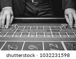 the croupier in the casino... | Shutterstock . vector #1032231598
