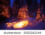 bonfire in the winter forest... | Shutterstock . vector #1032262144