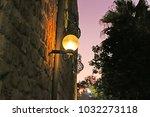 lamp on street of stone old... | Shutterstock . vector #1032273118