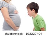 I do not want a little sister - young boy jealous of his unborn sister - stock photo