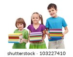 Smiling preschool and school kids with colorful books stacks - isolated - stock photo