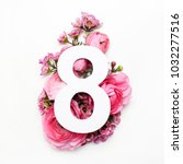 Small photo of Layout with colorful flowers, leaves and number eight. Flat lay. Top view.