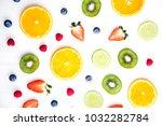 sliced fruits on white...   Shutterstock . vector #1032282784